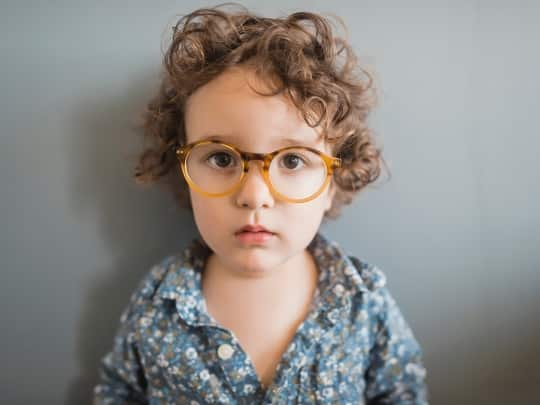 Allah the name of God, a kid with glasses