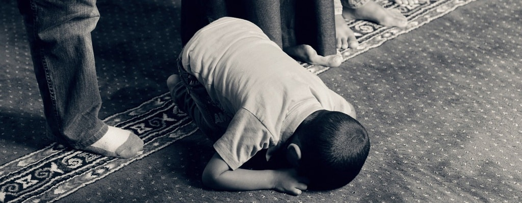 A praying kid, God is The Pardoner.